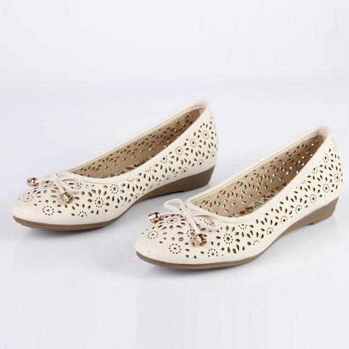 Женские туфли перфорированные с бантиком