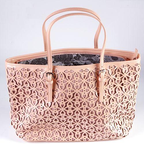 Женская сумка на молнии, украшенная перфорацией